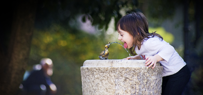 drinking from water fountain in the park